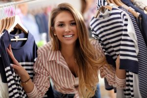 Picture showing happy woman shopping for clothes